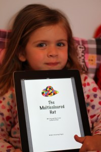 Kaci Cooper (Age 3) with The Multicoloured Hat on her iPad